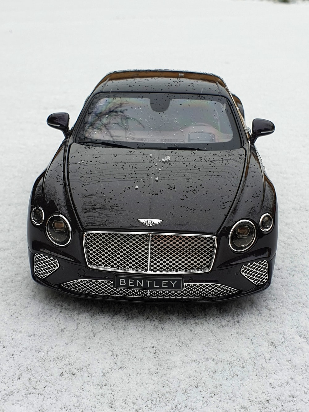 black mercedes benz c class on snow covered ground
