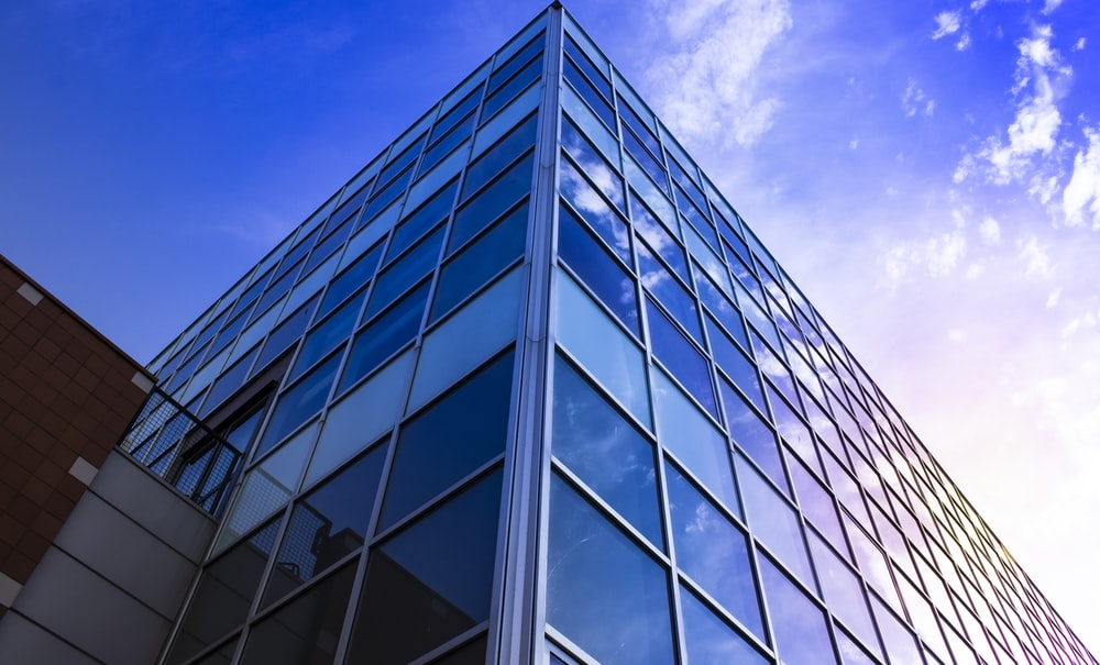 glass walled high rise building under blue sky during daytime