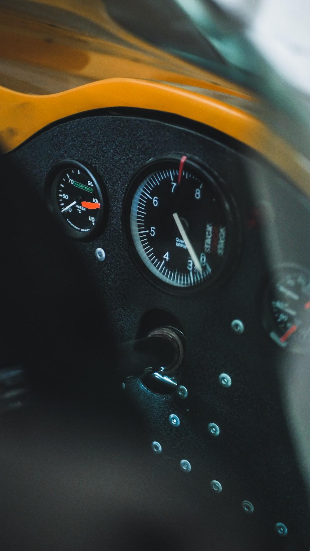 black and white analog speedometer
