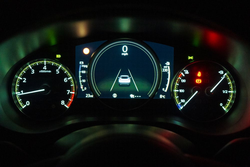 black and white car instrument panel cluster