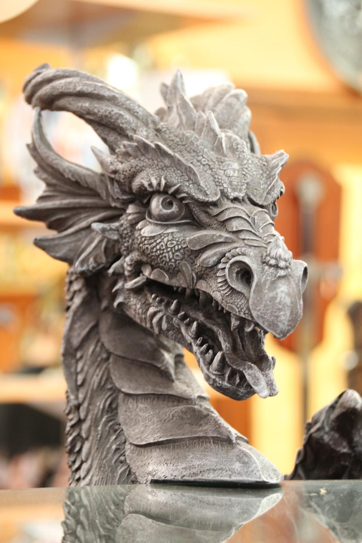 gray dragon statue in tilt shift lens