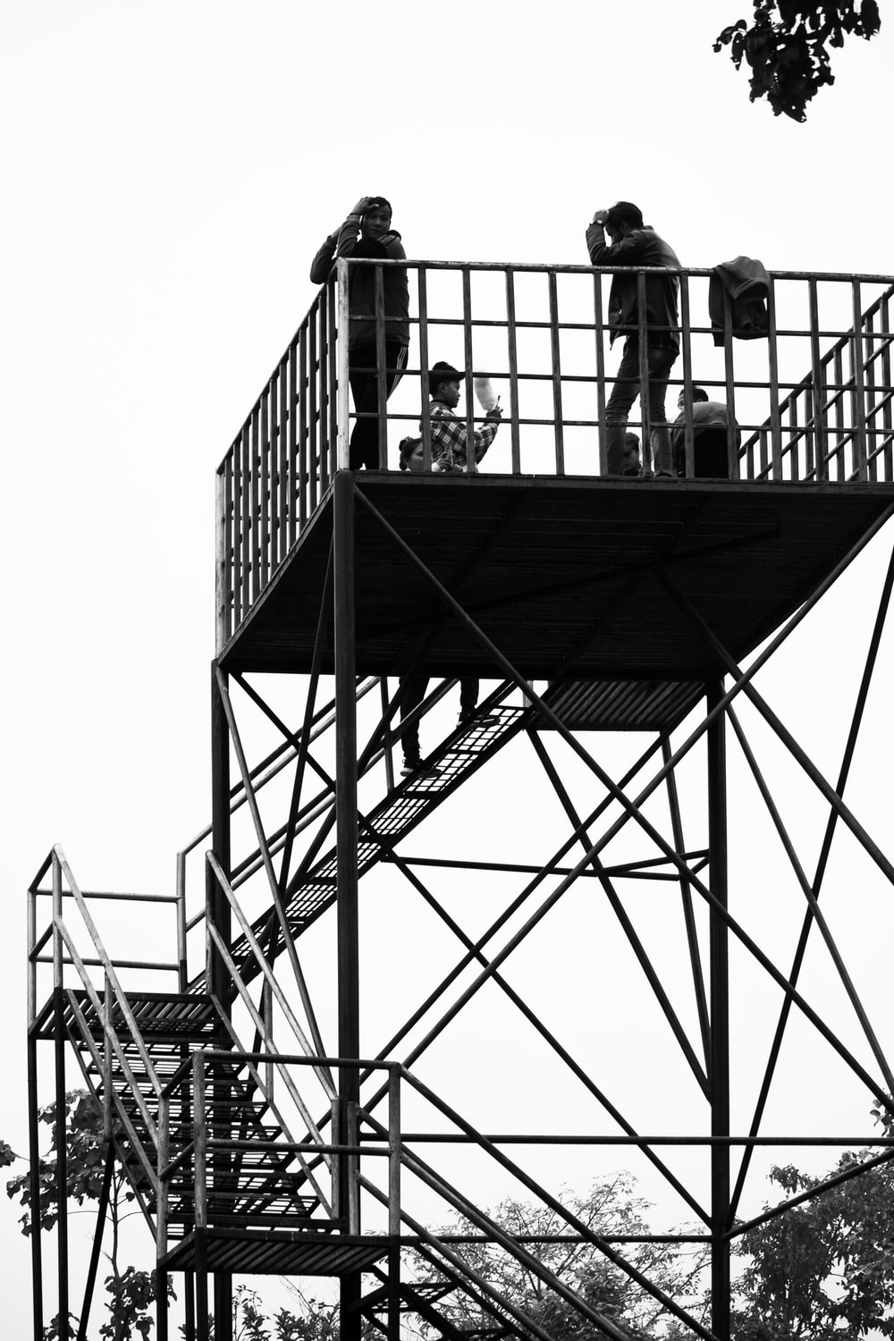 silhouette of people on top of building