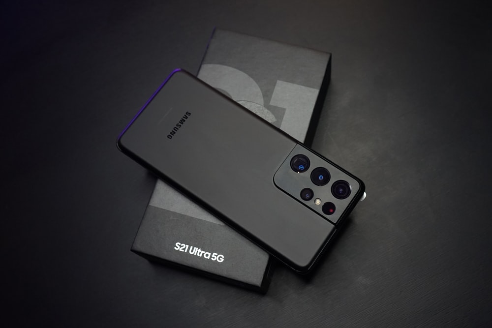 black sony remote control beside white tissue paper