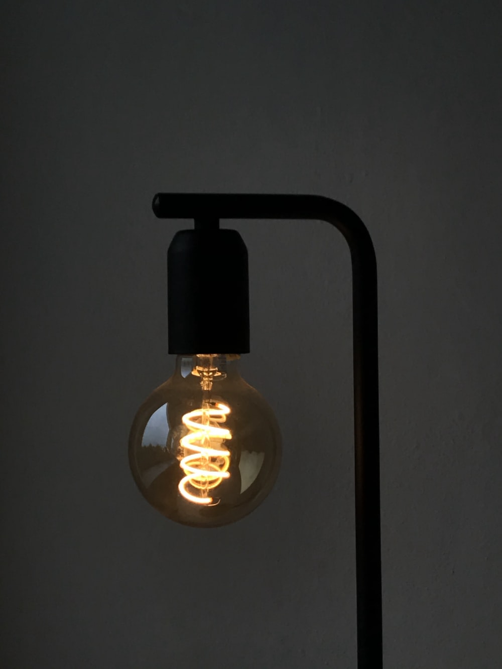 clear glass light bulb turned on in room