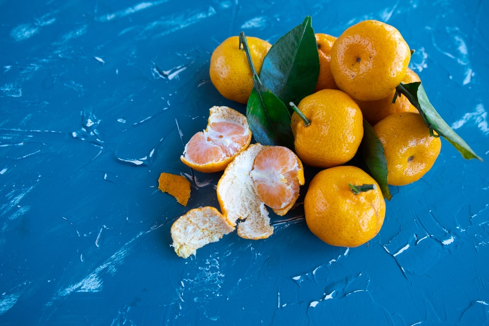 orange fruit on blue surface