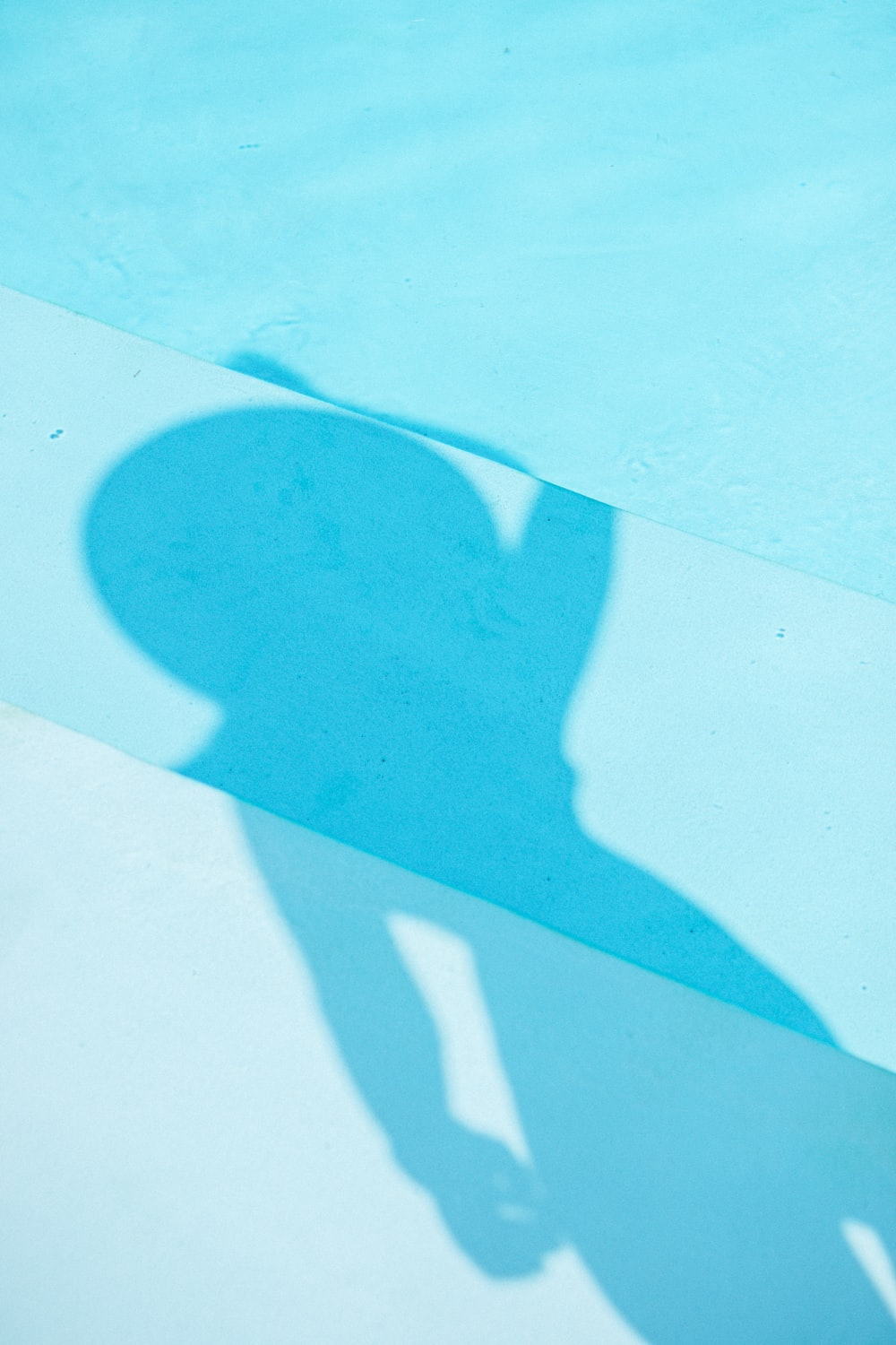 shadow of person on white sand