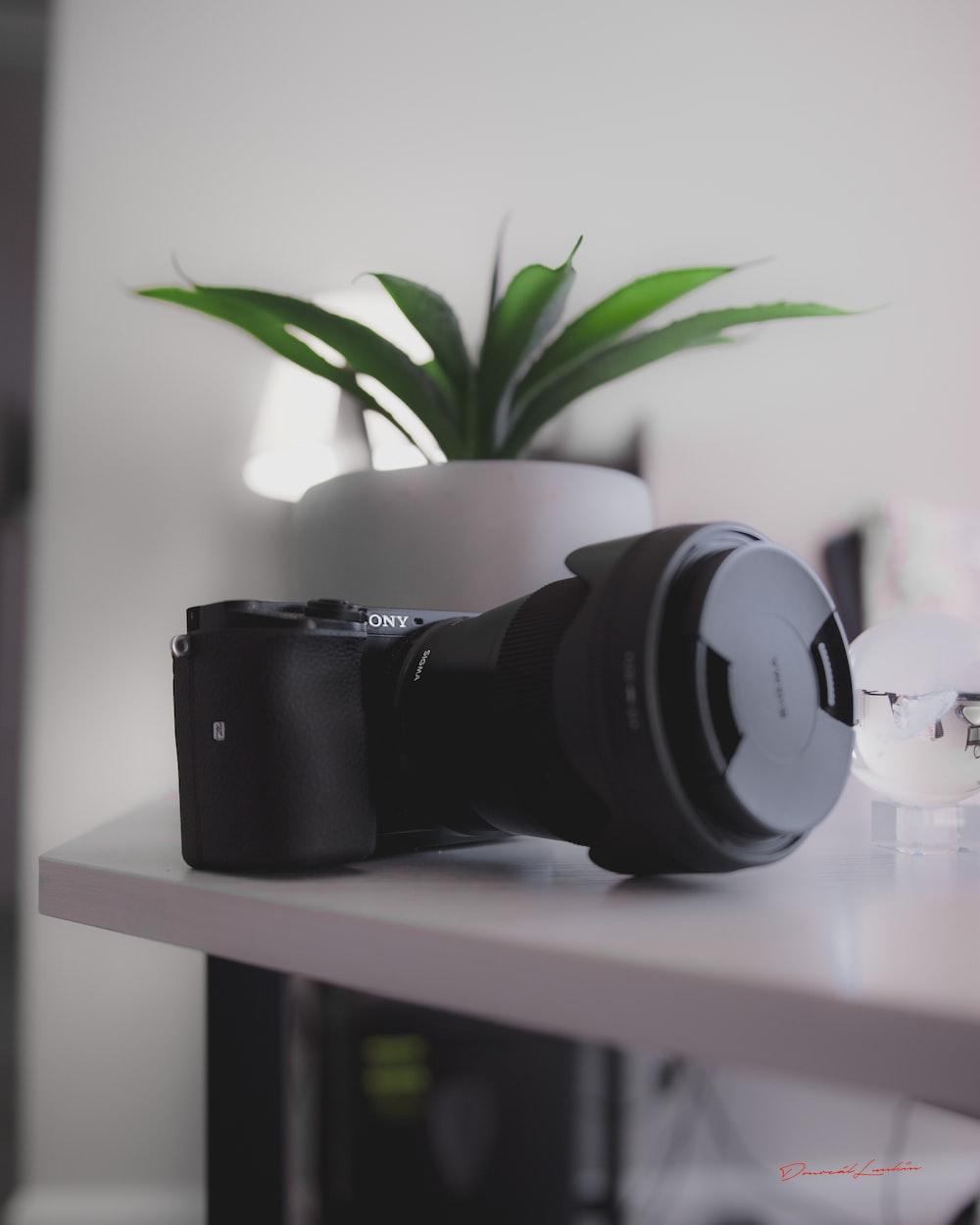 black and white headphones on white wooden shelf