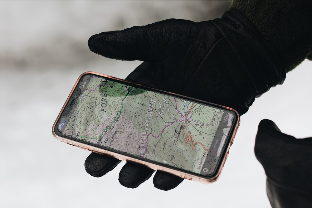 person holding iphone 6 with case