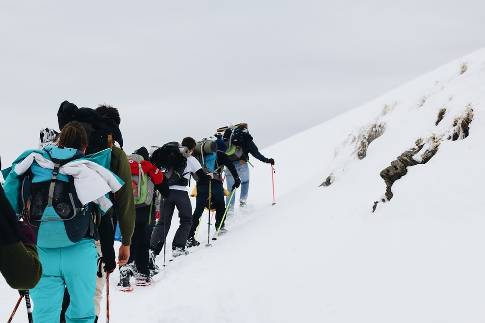 people on snow covered mountain during daytime