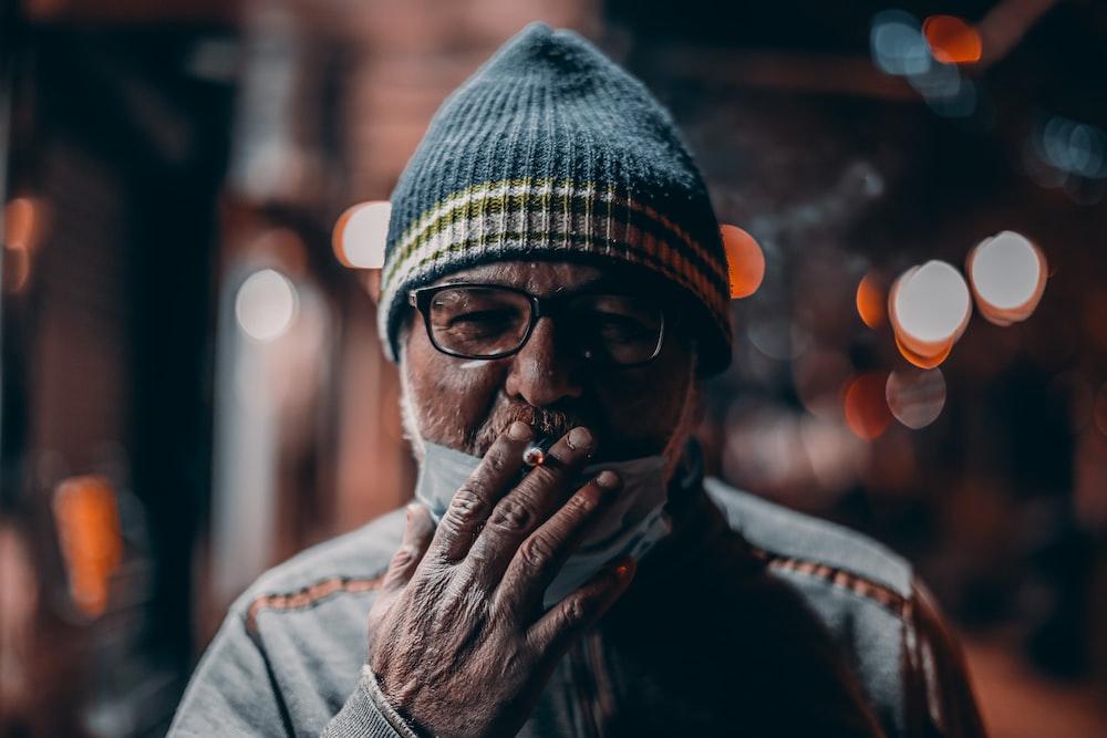 man in gray jacket wearing knit cap