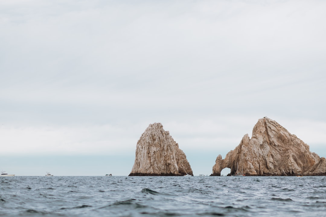Brown Rock Formation On Sea During Daytime - unsplash
