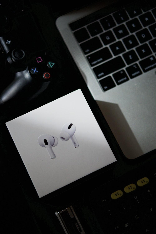 white earbuds on white box