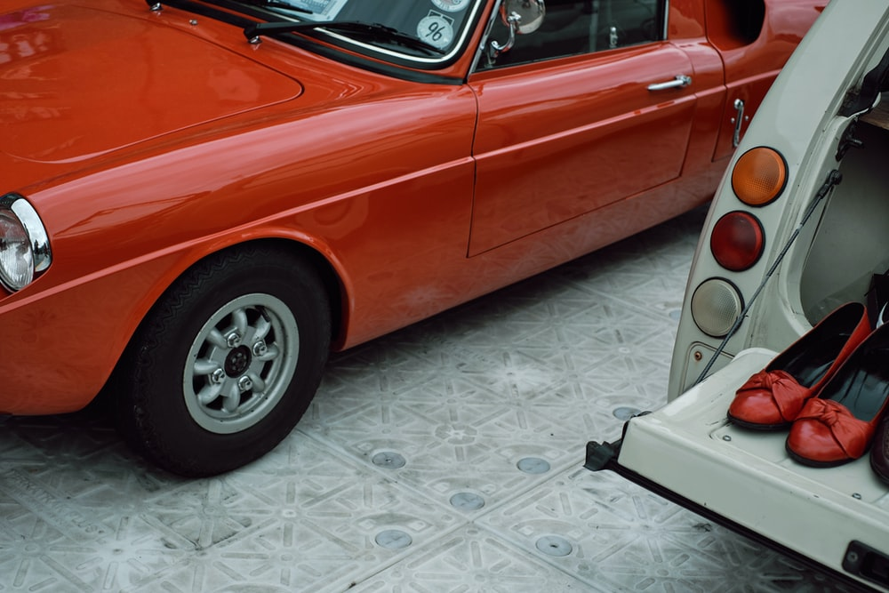 red car on white and gray floor tiles