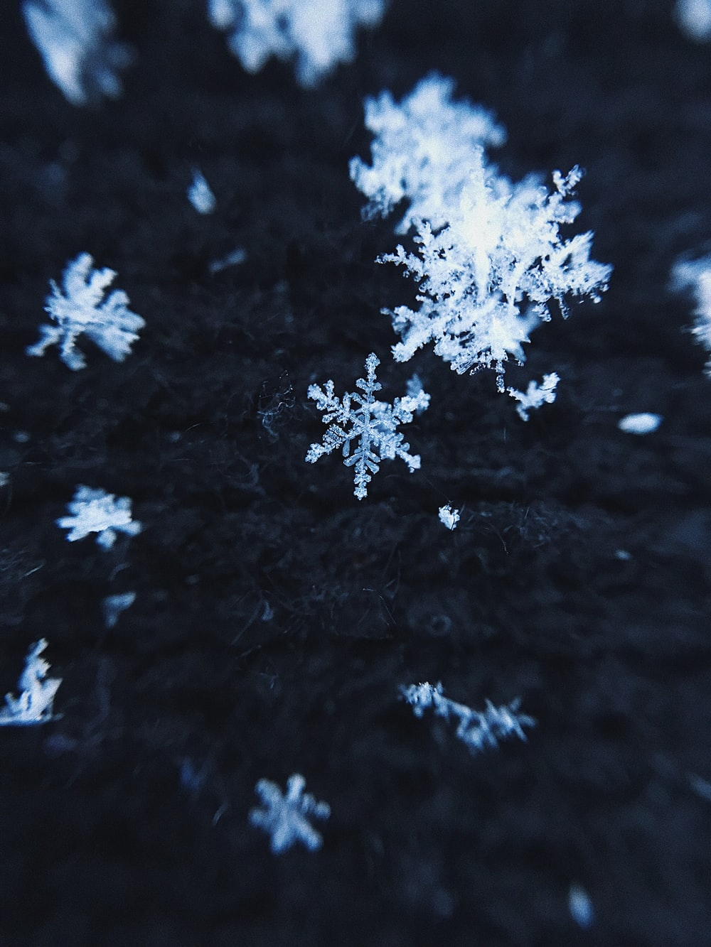 white snow on black background