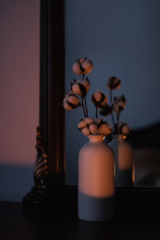 white ceramic vase with yellow flowers