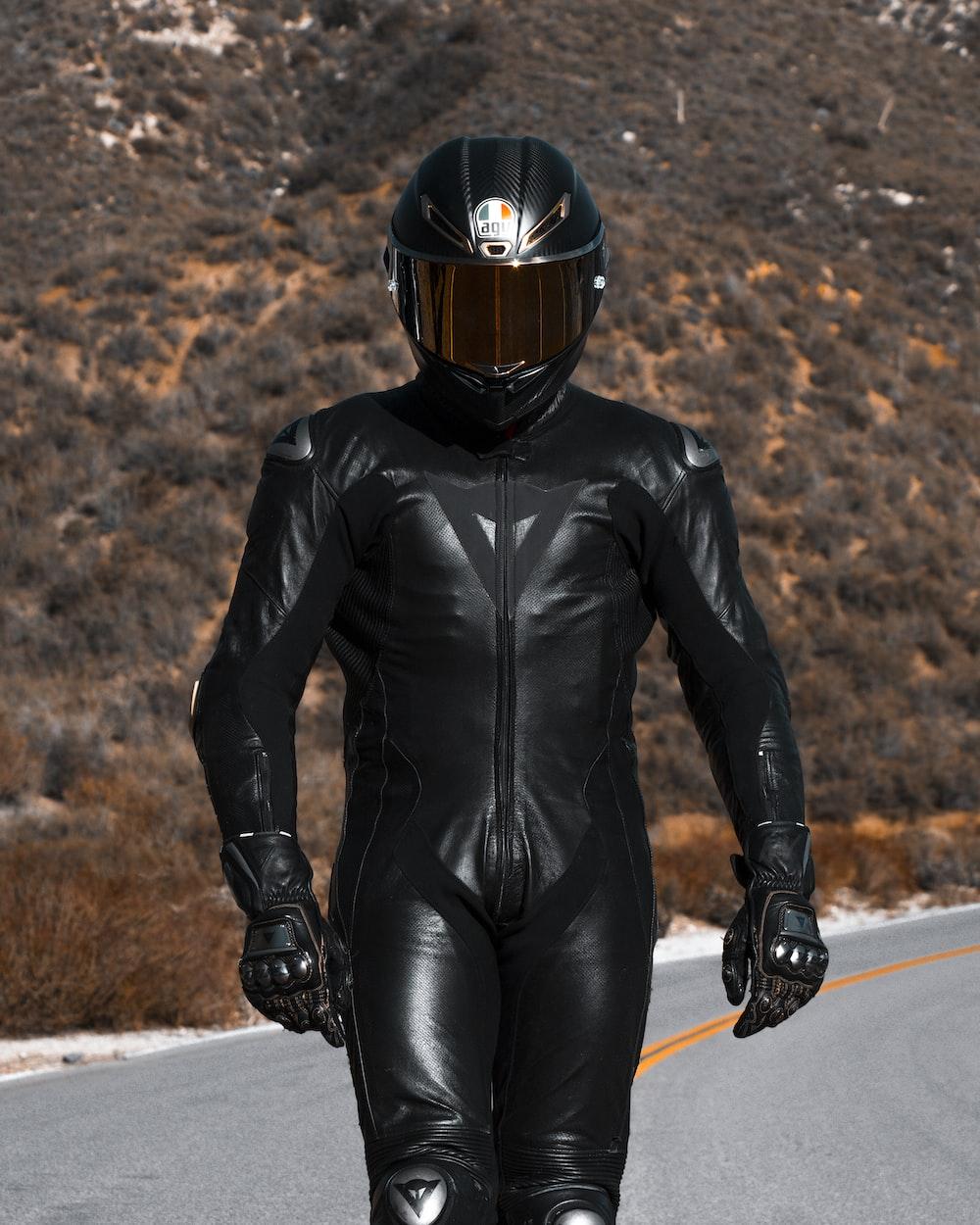 man in black leather jacket wearing helmet