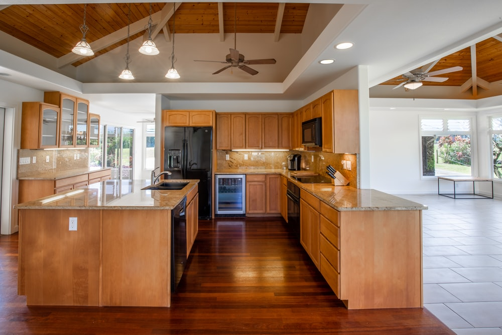 brown wooden kitchen cabinet with white kitchen counter top