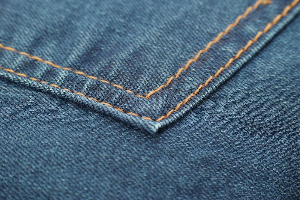blue denim textile with white button