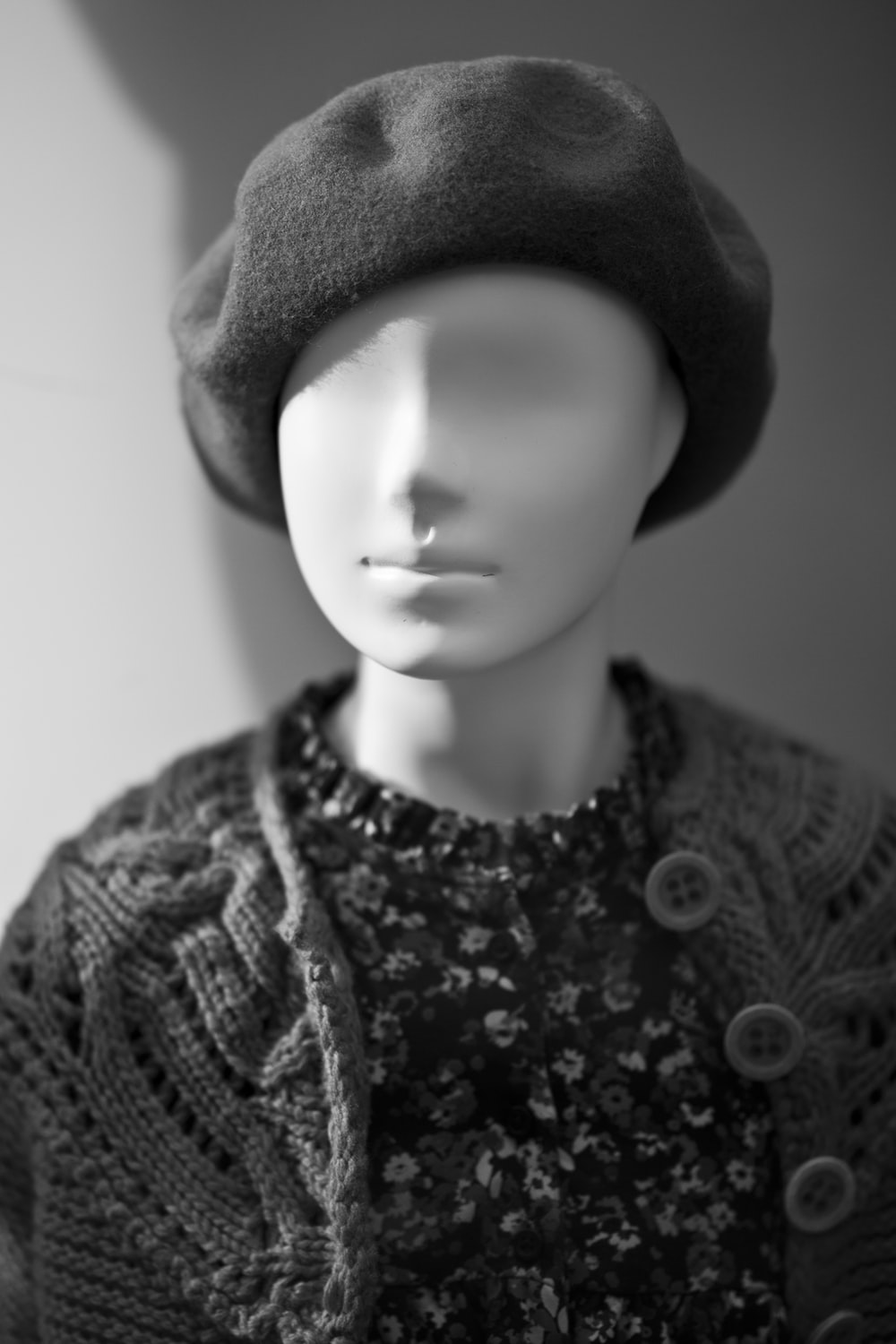 grayscale photo of woman wearing knit cap and knit shirt