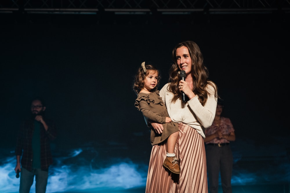 woman in brown coat standing beside woman in brown coat