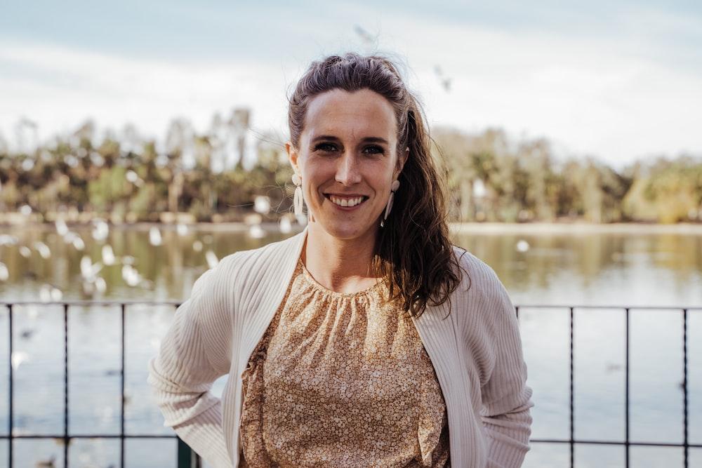 woman in white cardigan smiling