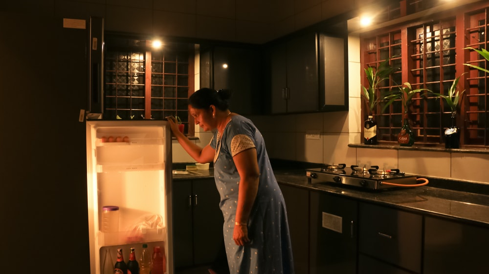 woman in gray t-shirt standing in kitchen