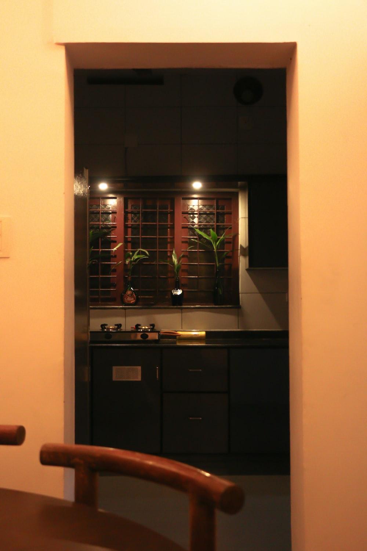 black wooden cabinet near brown wooden door