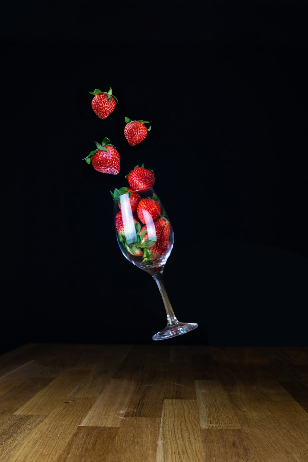strawberries on clear glass footed cup