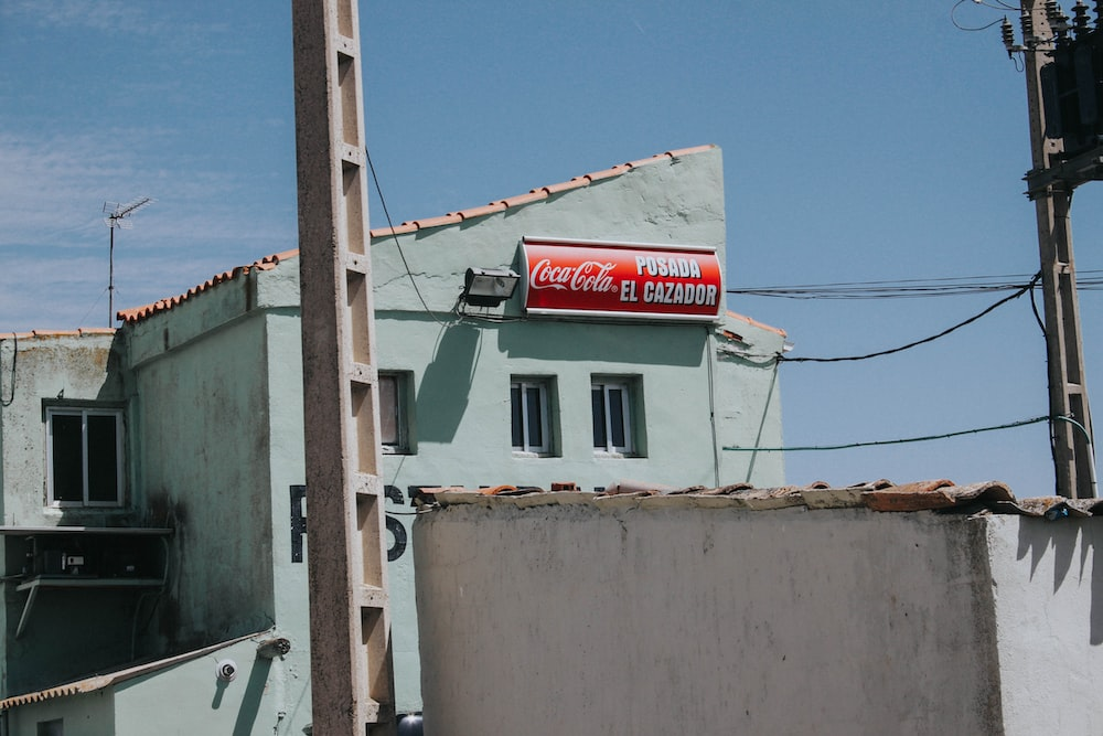 white and red coca cola signage