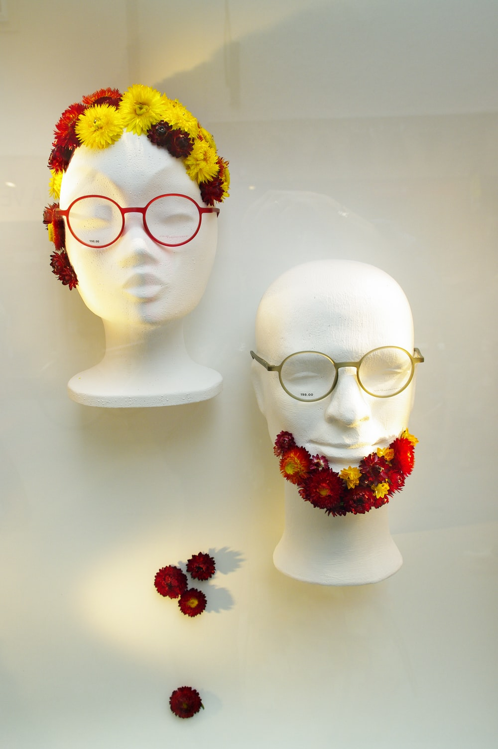 white ceramic figurine with yellow and red flower