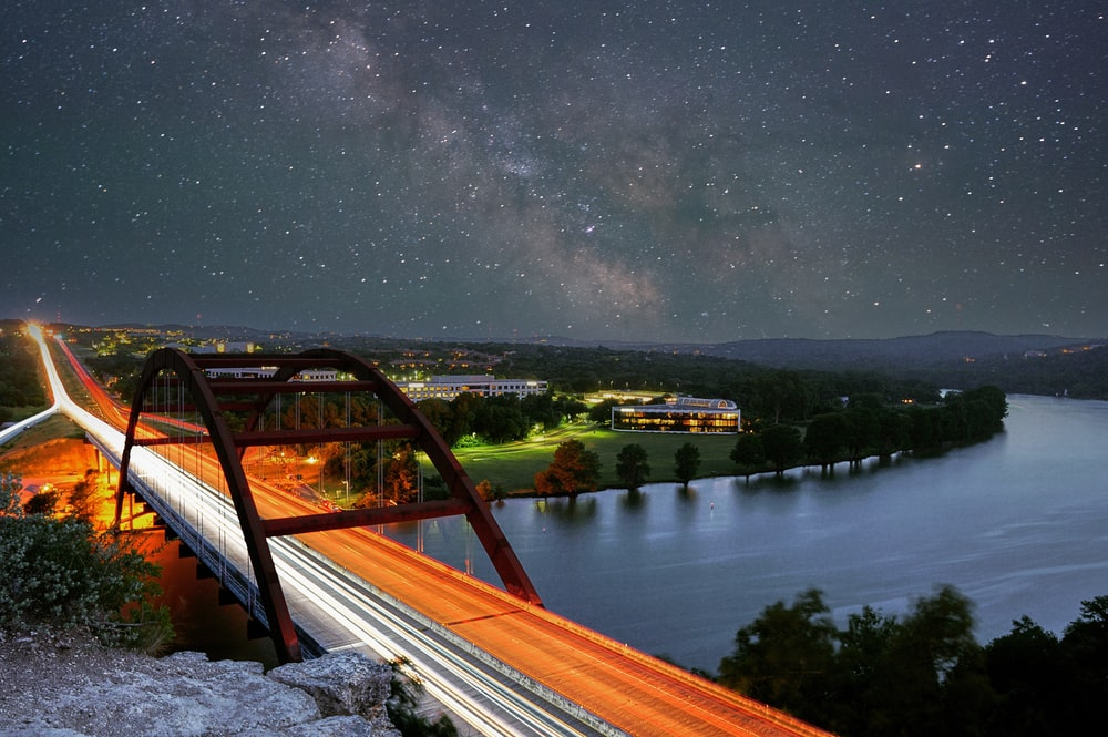 brown wooden bridge over river during night time
