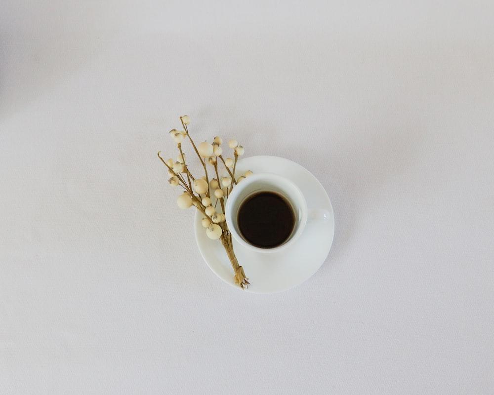 white ceramic mug on white saucer