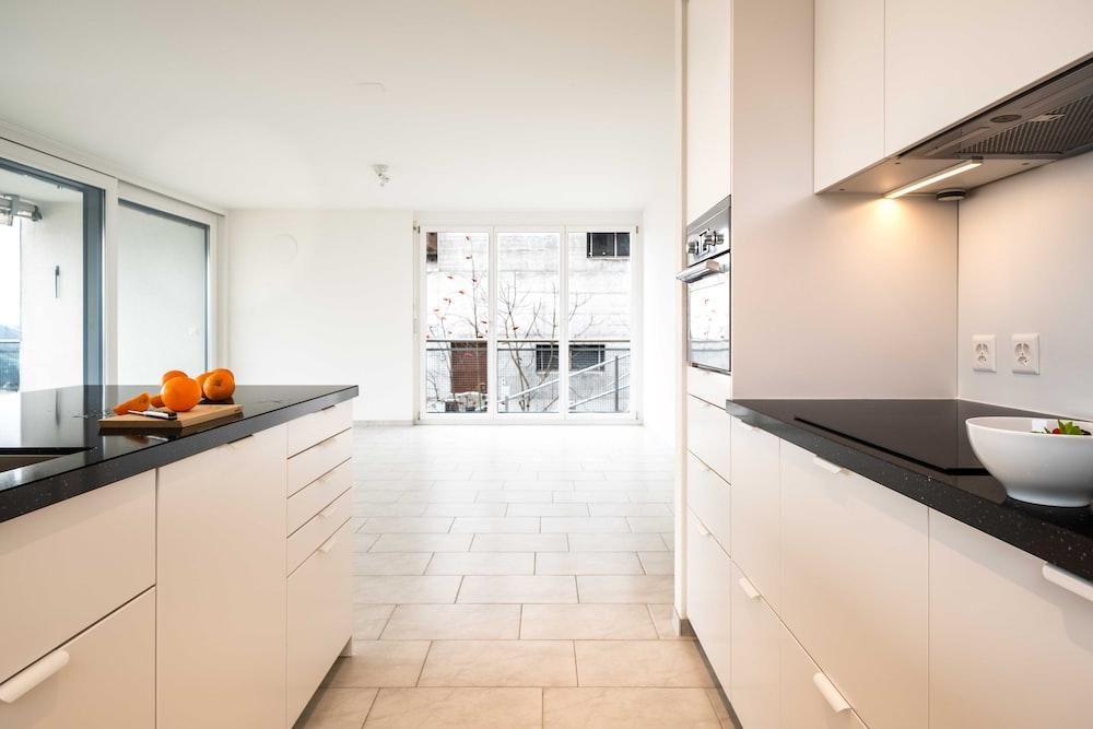 white wooden kitchen cabinet near black flat screen tv