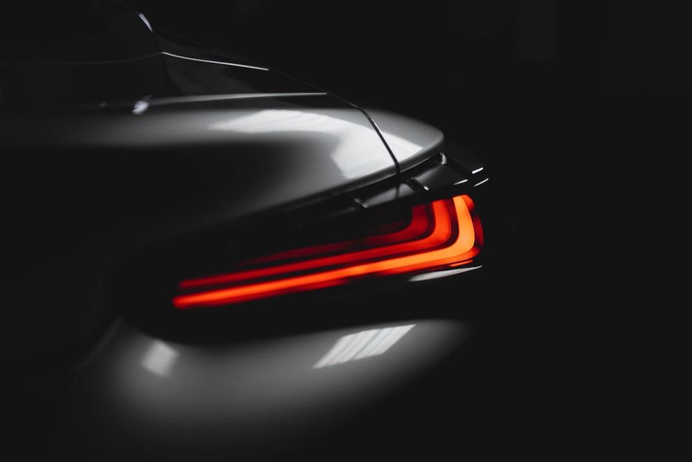 black and orange car in a dark room