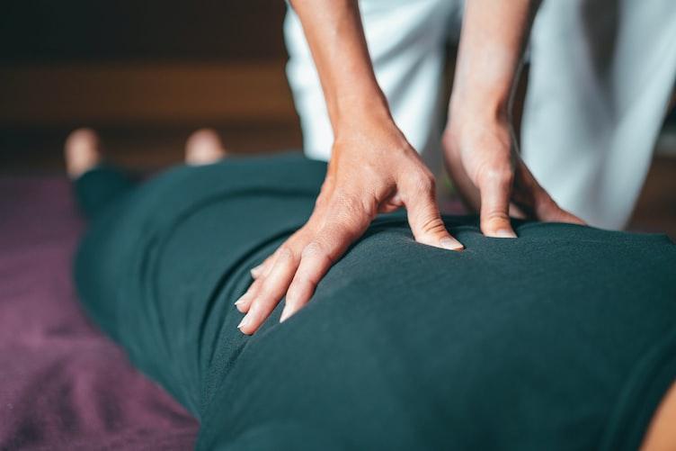 person getting massage therapy in Preston