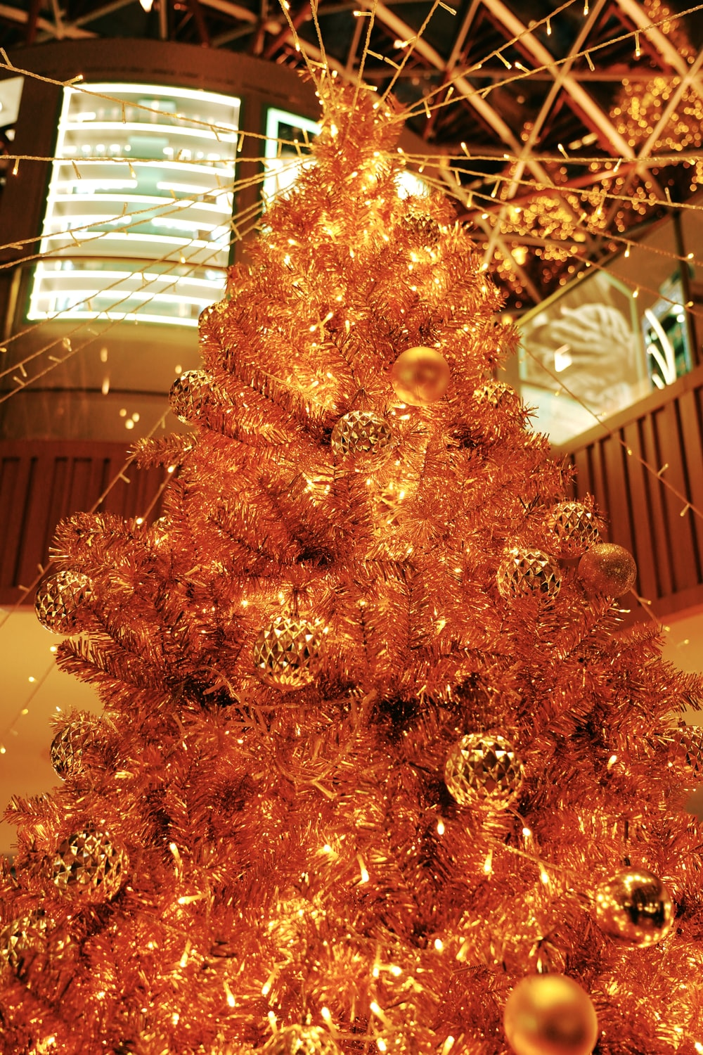 gold christmas tree with gold baubles