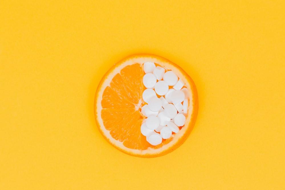 orange fruit slices on yellow surface