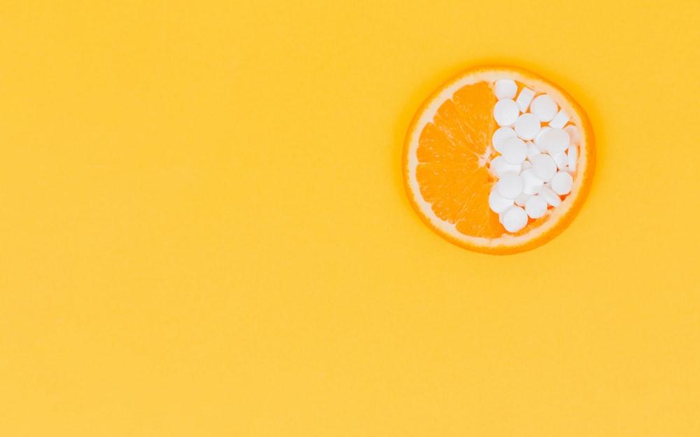 orange fruit with white round fruits