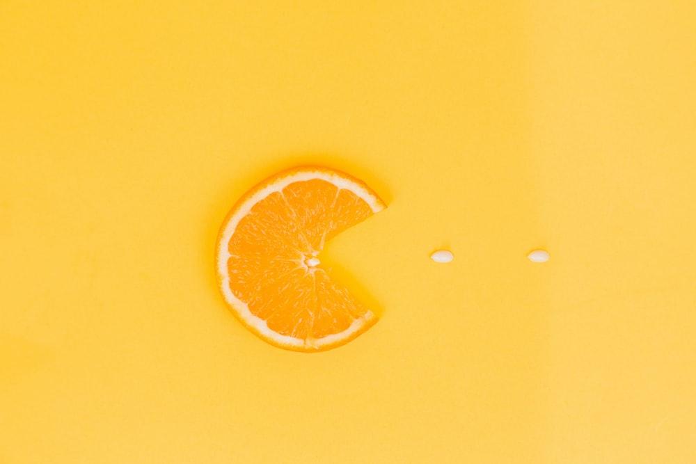 orange fruit on yellow surface