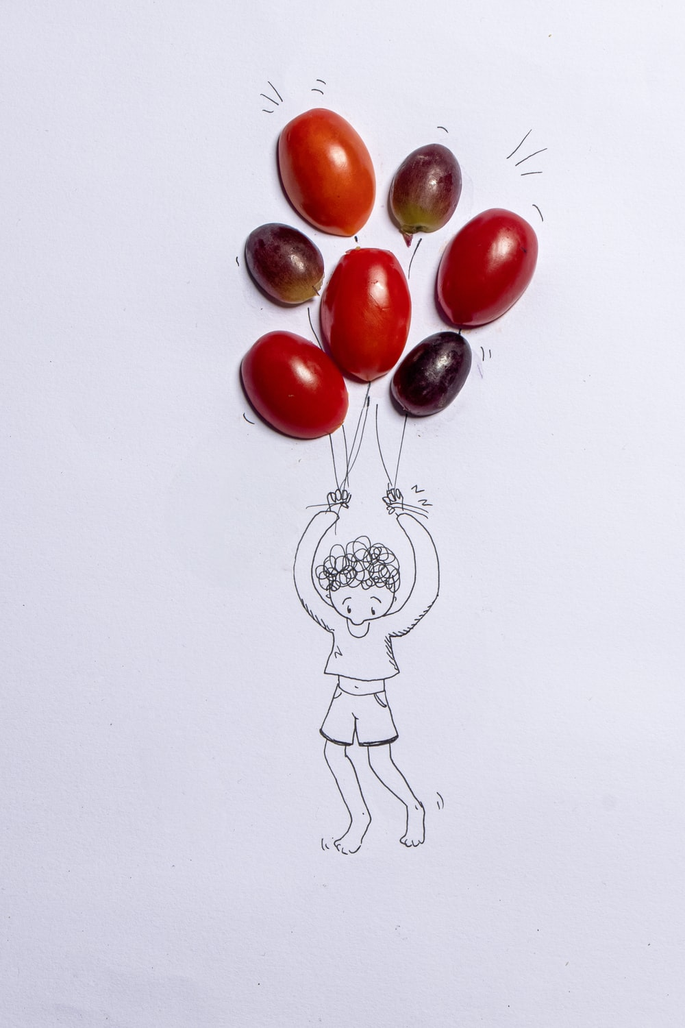 red cherry fruit on white surface