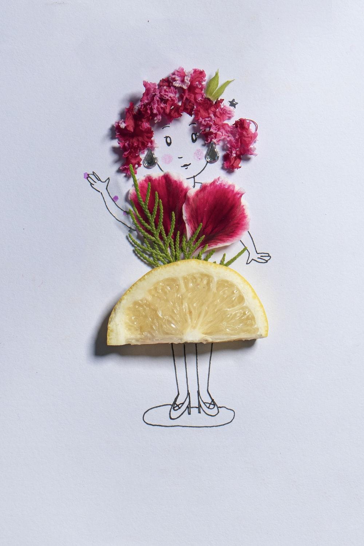 sliced lemon beside pink flowers
