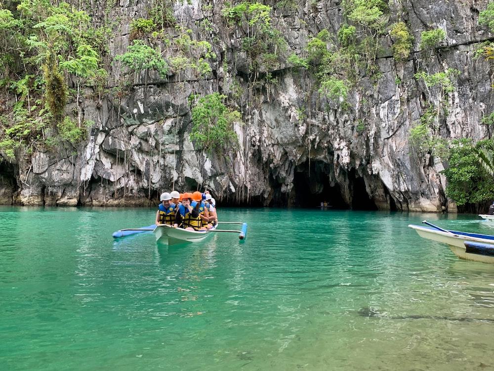 people riding on kayak on river during daytime