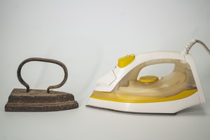 white and blue clothes iron