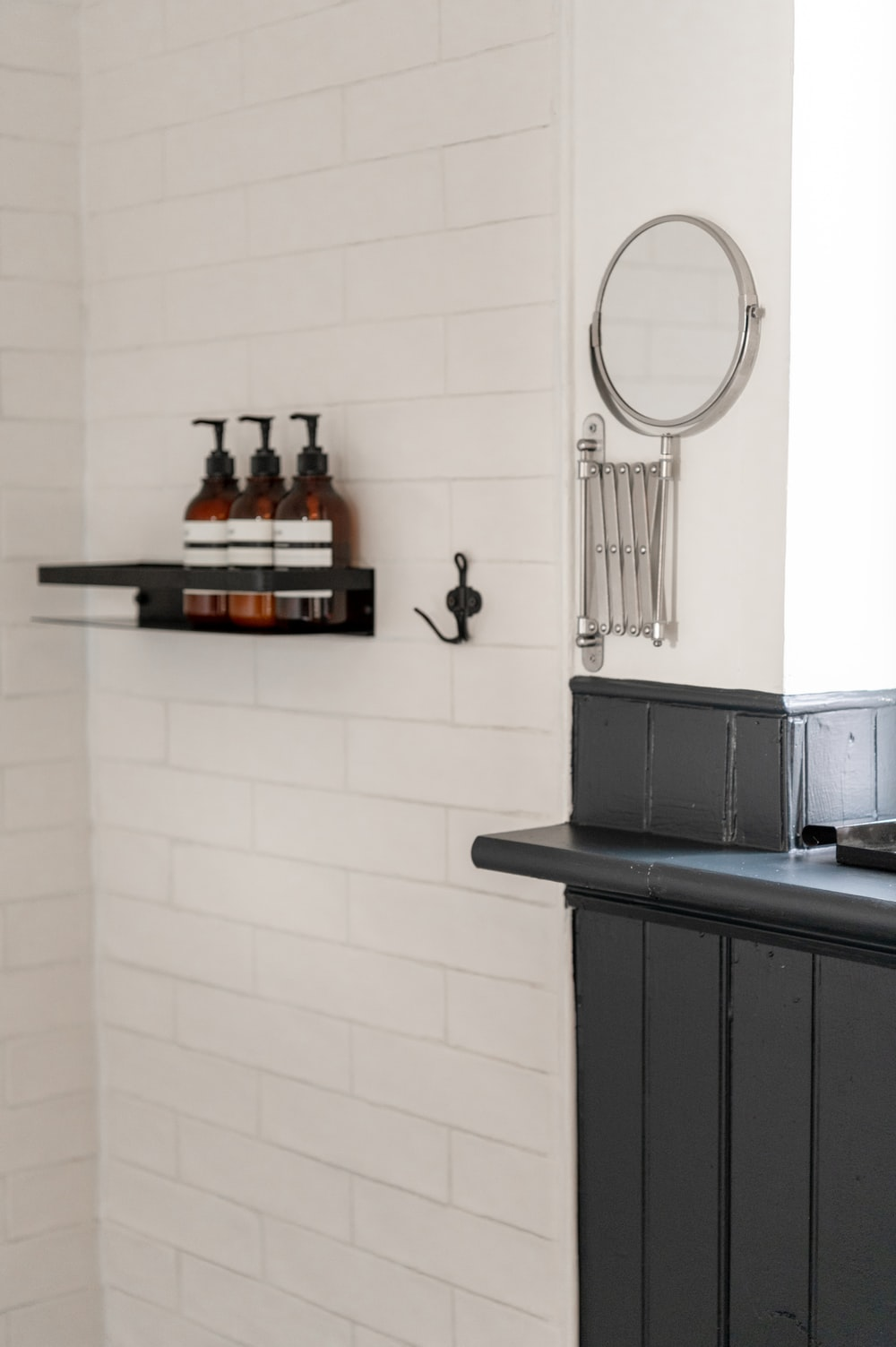 black wooden cabinet with mirror
