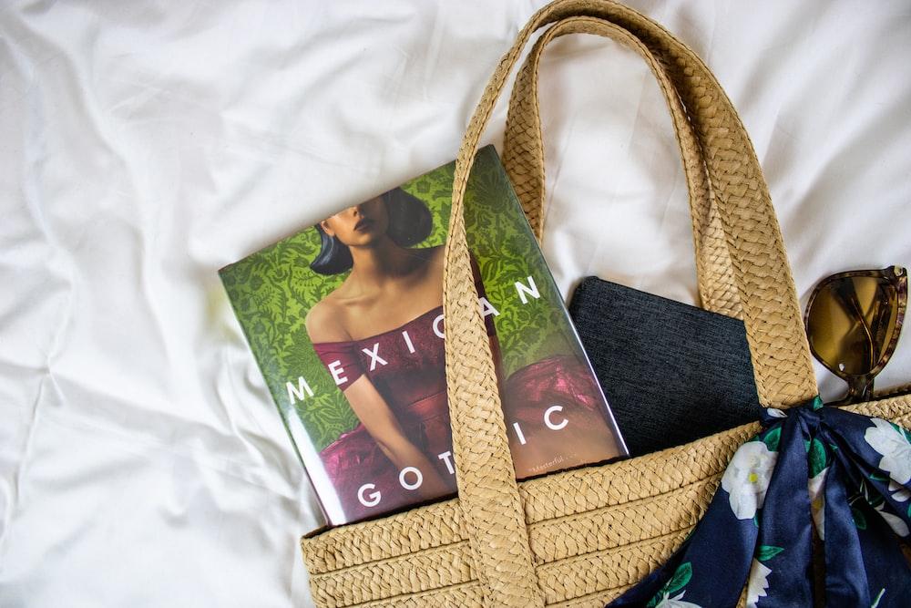 brown woven handbag on white textile