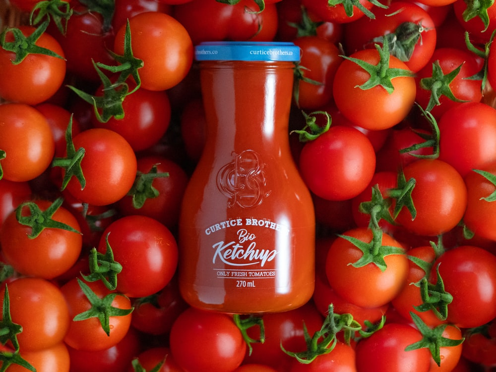 tomato sauce bottle on brown wooden table