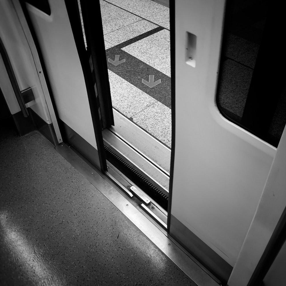gray scale photo of a train