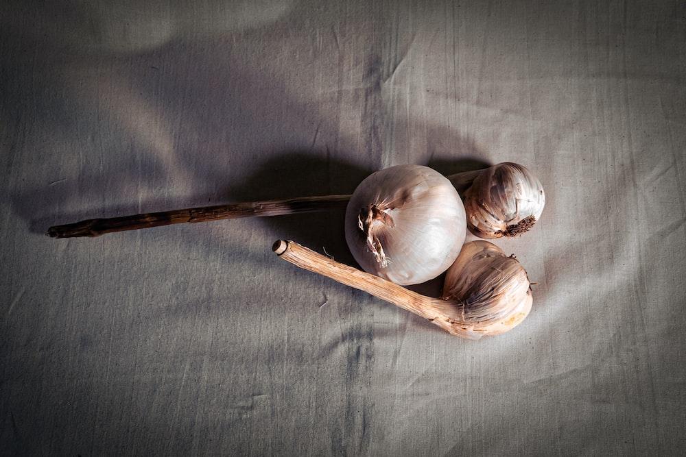white garlic on gray textile