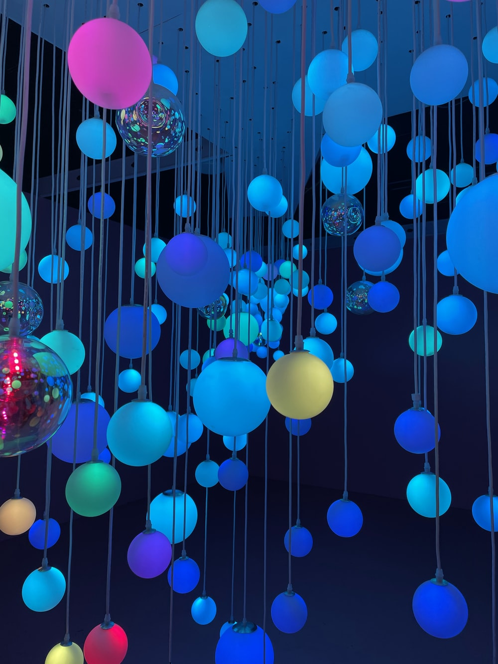 blue and pink balloons with water droplets