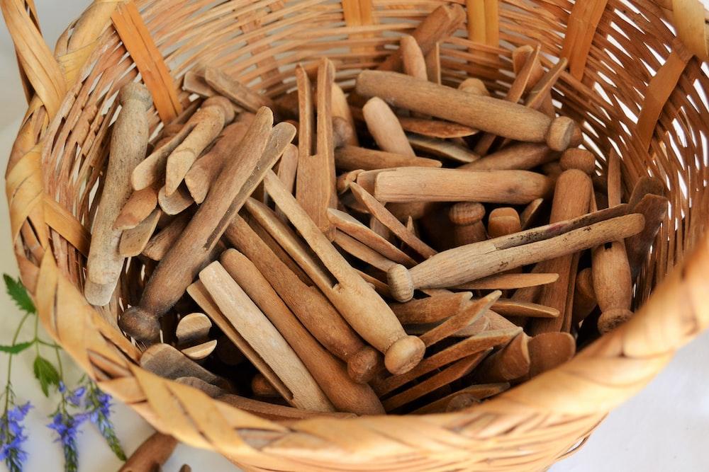 brown wooden sticks on brown woven basket